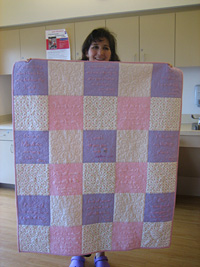 Lynette Thweatt with Quilt